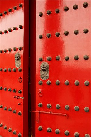 Red doors with Lion heads Stock Photo - Rights-Managed, Code: 849-03645587