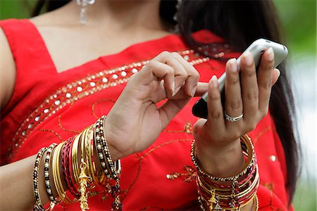 singapore traditional costume lady - Close up of Indian woman texting on phone Stock Photo - Rights-Managed, Code: 849-03645718