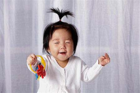 Chinese baby smiling with eyes closed Stock Photo - Rights-Managed, Code: 849-03775995