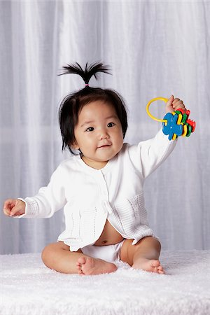 Young baby holding toy keys Stock Photo - Rights-Managed, Code: 849-03776036