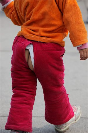 Young girl with bum exposed through split in pants Stock Photo - Rights-Managed, Code: 849-03901223