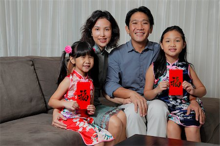 singapore traditional costume lady - Chinese family sitting together with daughters holding red envelopes (Hong Bao) Stock Photo - Rights-Managed, Code: 849-03901235