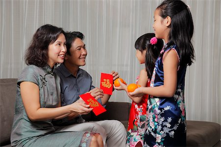 singapore traditional costume lady - Chinese parents giving red envelopes (Hong Bao) to their daughters during Chinese New Year Stock Photo - Rights-Managed, Code: 849-03901237