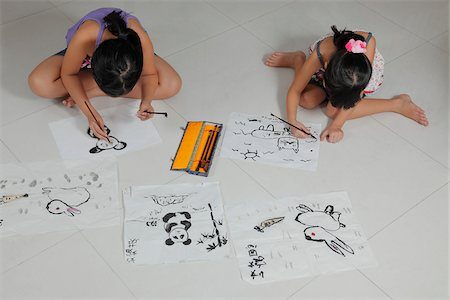 entry field - Young girls drawing pictures with Chinese brush and ink Stock Photo - Rights-Managed, Code: 849-03901242