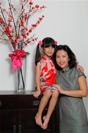 singapore traditional costume lady - Chinese mother and daughter wearing Cheongsams sitting near flowers Stock Photo - Rights-Managed, Code: 849-03901271