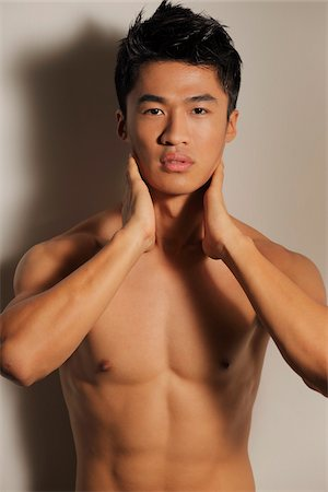shirtless men - Shirtless young man with hands on neck Stock Photo - Rights-Managed, Code: 849-03901285
