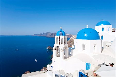 Blue domed churches in the village of Oia, Santorini (Thira), Cyclades Islands, Aegean Sea, Greek Islands, Greece, Europe Stock Photo - Rights-Managed, Code: 841-05784794