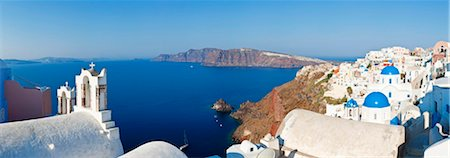 Blue domed churches in the village of Oia, Santorini (Thira), Cyclades Islands, Aegean Sea, Greek Islands, Greece, Europe Stock Photo - Rights-Managed, Code: 841-05784795