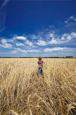 farm and boys - Boy running in wheat field, France, Europe Stock Photo - Rights-Managed, Code: 841-05784856