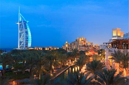 Burj Al Arab viewed from the Madinat Jumeirah Hotel at dusk, Jumeirah Beach, Dubai, United Arab Emirates, Middle East Stock Photo - Rights-Managed, Code: 841-05785633