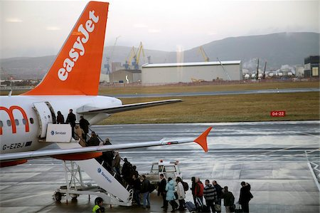 Easyjet passengers boarding at Belfast City airport, Belfast, Ulster, Northern Ireland, United Kingdom, Europe Stock Photo - Rights-Managed, Code: 841-05781085