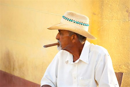 Local man wearing a straw hat and smoking a cigar, Trinidad, Cuba, West Indies, Central America Stock Photo - Rights-Managed, Code: 841-05781401