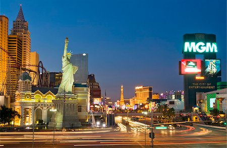 New York-New York hotel with roller coaster, and light trails at night of traffic at the intersection of The Strip, Las Vegas Boulevard South and West Tropicana Avenue, Las Vegas, Nevada, United States of America, North America Stock Photo - Rights-Managed, Code: 841-05782313