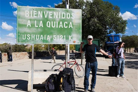people in argentina - Hitchhiker at the border of Bolivia and Argentina, sign showing 5121km to Ushuaia at the bottom on Argentina, Argentina, South America Stock Photo - Rights-Managed, Code: 841-05782789