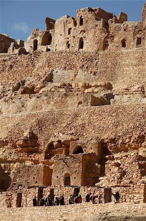 Troglodyte cave dwellings and granary niches known as ghorfas, hillside Berber village of Chenini, Tunisia, North Africa, Africa Stock Photo - Rights-Managed, Code: 841-05794642
