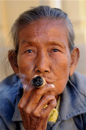 Old woman smokes a marihuana cigar, Bagan, Myanmar, Asia Stock Photo - Rights-Managed, Code: 841-05794778