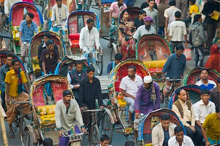 dhaka - Busy rickshaw traffic on a street crossing in Dhaka, Bangladesh, Asia Stock Photo - Rights-Managed, Code: 841-05794824