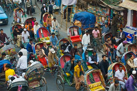 dhaka - Busy rickshaw traffic on a street crossing in Dhaka, Bangladesh, Asia Stock Photo - Rights-Managed, Code: 841-05794825