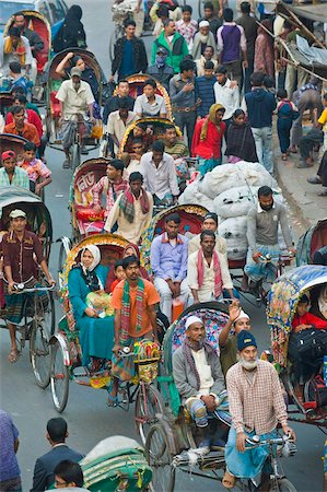 dhaka - Busy rickshaw traffic on a street crossing in Dhaka, Bangladesh, Asia Stock Photo - Rights-Managed, Code: 841-05794826