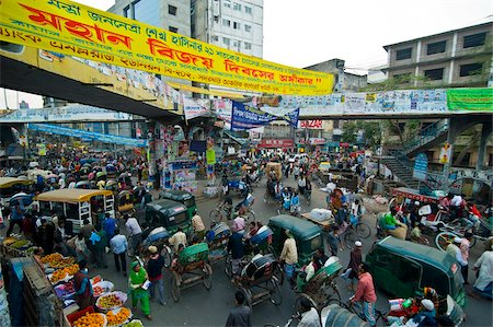 dhaka - Busy rickshaw traffic on a street crossing in Dhaka, Bangladesh, Asia Stock Photo - Rights-Managed, Code: 841-05794828
