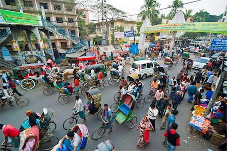 dhaka - Busy rickshaw traffic on a street crossing in Dhaka, Bangladesh, Asia Stock Photo - Rights-Managed, Code: 841-05794829