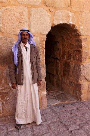 The gate keeper stands by the single entrance to the UNESCO World Heritage Site of St. Catherine's Monastery, Sinai Peninsula, Egypt, North Africa, Africa Stock Photo - Rights-Managed, Code: 841-05795356