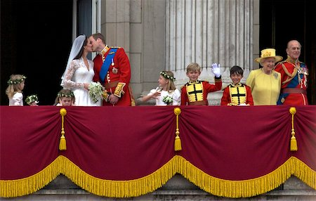 Prince William kisses his new wife Catherine Duchess of Cambridge during their public appearance on the balcony of Buckingham Palace, on their wedding day, London, England, United Kingdom, Europe Stock Photo - Rights-Managed, Code: 841-05795929