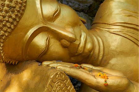 Detail of statue of Buddha, Phu Si Hill, Luang Prabang, UNESCO World Heritage Site, Laos, Indochina, Southeast Asia, Asia Stock Photo - Rights-Managed, Code: 841-05796408
