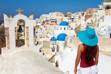 santorini island - Tourist and church with blue dome, Oia (Ia) village, Santorini, Cyclades, Greek Islands, Greece, Europe Stock Photo - Rights-Managed, Code: 841-05796735