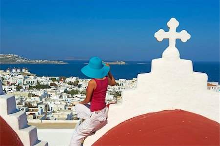 Tourist on roof of red church above the old town, Mykonos town, Chora, Mykonos, Cyclades, Greek Islands, Greece, Europe Stock Photo - Rights-Managed, Code: 841-05796757