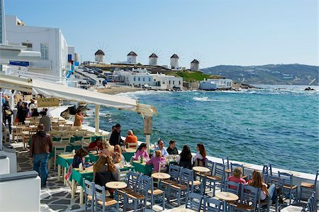 european cafe bar - Cafe bar on the sea side with the five windmills (Kato Mili) beyond, Little Venice, Mykonos Town, Chora, Mykonos Island, Cyclades, Greek Islands, Greece, Europe Stock Photo - Rights-Managed, Code: 841-05796765