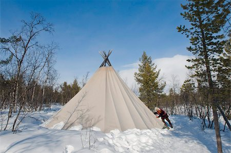 Sami man closes the flap on his lavvu tent at his homestead, Kiruna, Lapland, arctic Sweden, Scandinavia, Europe Stock Photo - Rights-Managed, Code: 841-05797006