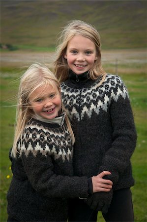 Icelandic girls, blond haired sisters aged 11 and 7, in traditional woollen sweaters, Fluguyri horse farm, Skagafjordur, Iceland, Polar Regions Stock Photo - Rights-Managed, Code: 841-05797029