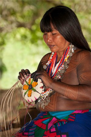 panama traditional costume - Embera woman weaves a shallow basket, Embera Drua Village, Chagres River, Soberania National Park, Panama, Central America Stock Photo - Rights-Managed, Code: 841-05797068