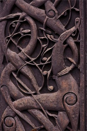 stave - Detail of wood carving on exterior of Urnes Stave church built in 1150, UNESCO World Heritage Site, Luster village, Norway, Scandinavia, Europe Stock Photo - Rights-Managed, Code: 841-05797076