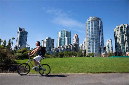 placing - Cyclist passing apartment blocks, False Creek, Vancouver, British Columbia, Canada, North America Stock Photo - Rights-Managed, Code: 841-05846335