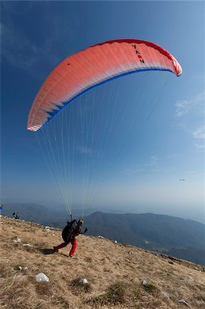 Paragliders flying over Mount Cuarnan, Udine, Friuli, Italy, Europe Stock Photo - Rights-Managed, Code: 841-05847131