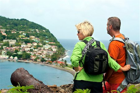 Couple at the remains of Scotts Fort atop Cachacrou headland overlooking Scotts Head, Dominica, Windward Islands, West Indies, Caribbean, Central America Stock Photo - Rights-Managed, Code: 841-05847663