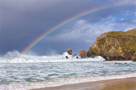 Sea stacks, rainbow, stormy clouds and rough seas on a windy afternoon at Dalmore Bay on the Isle of Lewis, Outer Hebrides, Scotland, United Kingdom, Europe Stock Photo - Rights-Managed, Code: 841-05848780