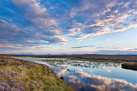 Evening reflections in a lochan on the peaty moreland of Lewis, with the mountains of Harris in the distance, Isle of Lewis, Outer Hebrides, Scotland, United Kingdom, Europe Stock Photo - Rights-Managed, Code: 841-05848791