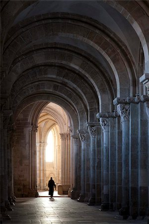 Interior north nave aisle with priest walking away, Vezelay Abbey, UNESCO World Heritage Site, Vezelay, Burgundy, France, Europe Stock Photo - Rights-Managed, Code: 841-05960494