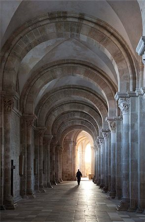 Interior north nave aisle with priest walking away, Vezelay Abbey, UNESCO World Heritage Site, Vezelay, Burgundy, France, Europe Stock Photo - Rights-Managed, Code: 841-05960493