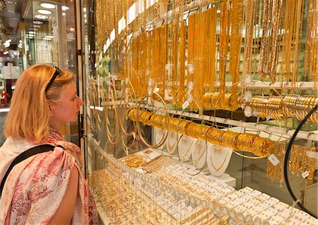 Female tourist shopping, Gold Souk Market, Deira, Dubai, United Arab Emirates, Middle East Stock Photo - Rights-Managed, Code: 841-05960650