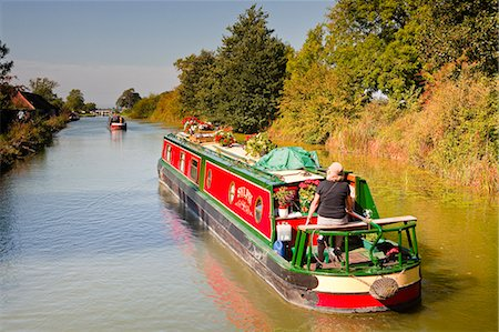 european - Canal boats idling their way down the Kennet and Avon Canal, Wiltshire, England, United Kingdom, Europe Stock Photo - Rights-Managed, Code: 841-06034297