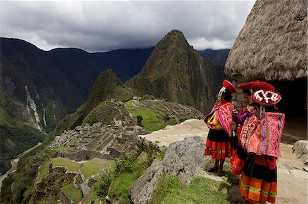 peru and culture - Traditionally dressed children looking over the ruins of the Inca city of Machu Picchu, UNESCO World Heritage Site, Vilcabamba Mountains, Peru, South America Stock Photo - Rights-Managed, Code: 841-06034484