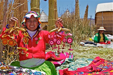 peru and culture - Portrait of a Uros Indian woman selling souvenirs, Islas Flotantes (Floating Islands), Lake Titicaca, Peru, South America Stock Photo - Rights-Managed, Code: 841-06034488