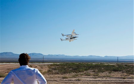 Virgin Galactic's White Knight 2 with Spaceship 2 above the runway at the Virgin Galactic Gateway spaceport, Upham, New Mexico, United States of America, North America Stock Photo - Rights-Managed, Code: 841-06030777