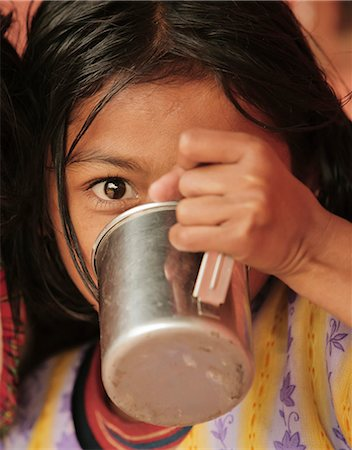 Young girl drinking from metal cup, Pokhara, Nepal, Asia Stock Photo - Rights-Managed, Code: 841-06030828