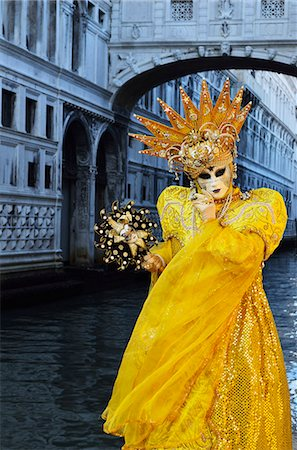 Masked figure in costume at the 2012 Carnival, with Ponte di Sospiri in the background, Venice, Veneto, Italy, Europe Stock Photo - Rights-Managed, Code: 841-06030938
