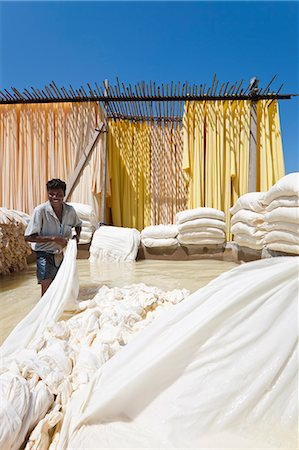 Washing fabric in a bleaching pool, Sari garment factory, Rajasthan, India, Asia Stock Photo - Rights-Managed, Code: 841-06031285